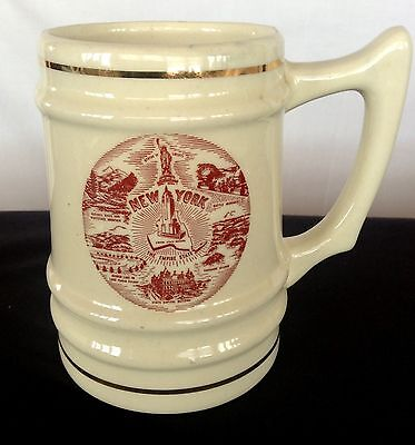 NYC Souvenir Mug Ivory with Red Brown Scenes of New York City Gold Trimmed