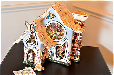 2002 BLUE SKY CLAYWORKS ROBIN'S SONG COTTAGE TEALIGHT HOLDER by Heather Goldminc