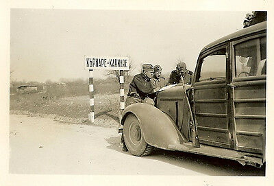 WHERE ARE WE? German Troops Check Map on Staff Car by Sign; KARNARE, Bulgaria!!!