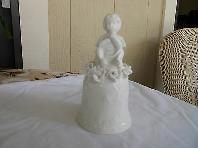 Angel on a bell with roses, cream. glazed ceramic