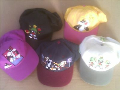 lot of 5 looney tunes hats and 1 hat pen six flags