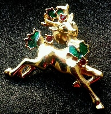 AVON Gold Tone Reindeer with Red Rhinestones and Green Enamel Leaves Pin