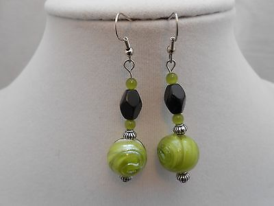 Handmade Green and Black glass beaded earrings with tibetan silver accents