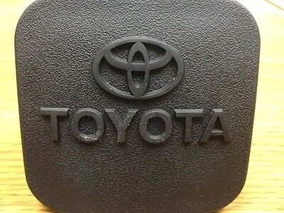Toyota Trailer Hitch 2 Inch Receiver Cover Plug with the word toyota and symbol
