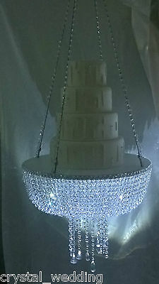 Stunning sparkling Crystal Chandelier suspended swing  wedding cake stand