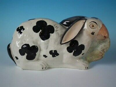 Staffordshire figure of a Rabbit eating lettuce