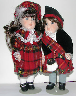 Alberon matching pair of Scottish laddie and lassie porcelain dolls - boxed.