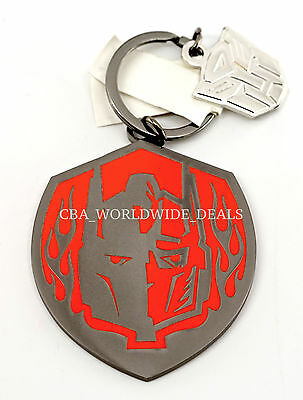 NEW Universal Studios Transformers Optimus Prime Autobot Red Keychain Badge