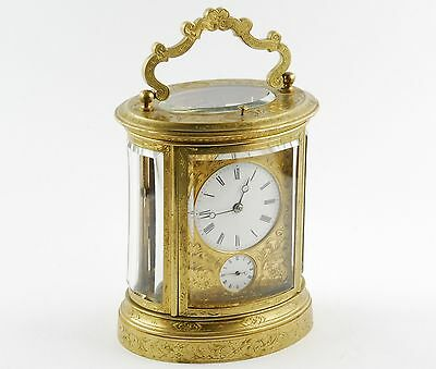 Antique 19th Century  French repeating carriage alarm clock, gilt brass, oval
