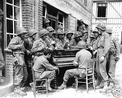 """Soldiers of the 2nd Armored Division sing """"Go to town"""" in Barenton, France 1944"""