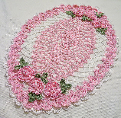 pink and white ^crocheted oval  roses doily  by Aeshagirl