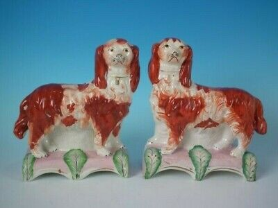 Pair Staffordshire King Charles spaniels on pink cushion bases