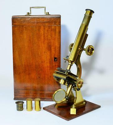 Large 19th Century brass microscope by Matthews of London c/w case, lenses