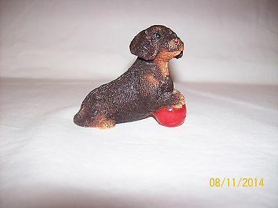 """Stone Dachshund Standing On Red Ball, 2.25""""x2.5""""long, No Label Blk, Tan & Red"""