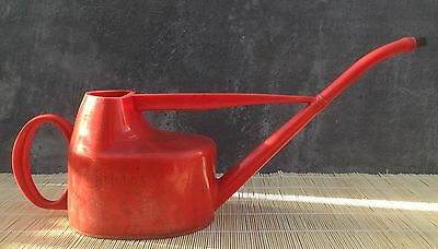 Vintage red thick plastic long reach watering can