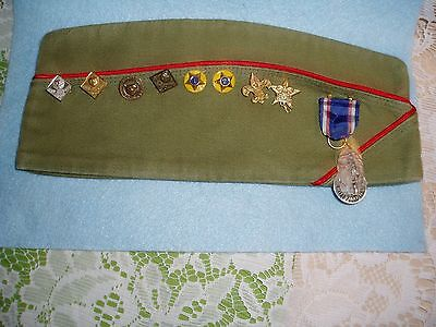 Great Vintage CUB/BOY SCOUT CAP (BSA) with 9 Medals/Pins on it. VALLEY FORGE,PA.