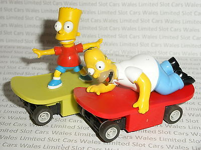 MICRO Scalextric - Pair of Homer & Bart Simpson Skateboards - vgc