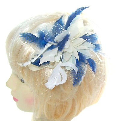 Hair fascinator flower in cream and  blue  suitable for weddings, races,prom