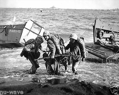 1945 With Enemy Fire Screaming overhead Marines Haul Ammo on Iwo Jima on D Day