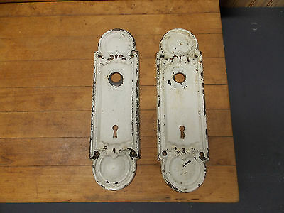 Pair of antique stamped brass door knob escutcheon plates