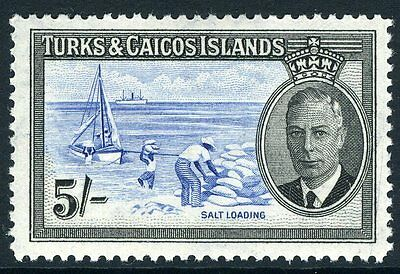 TURKS & CAICOS ISLANDS-1950 5/- Blue & Black Sg 233 MOUNTED MINT V10637