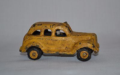 Vintage Yellow Painted Cast Iron Toy Taxi Cab Car with Driver