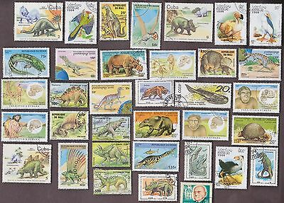 50 All Diff DINOSAURS & PREHISTORIC ANIMAL Stamps &