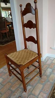 Pair of Mahogany ladder back chairs, hand carved.