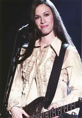 Alanis Morissette Playing Guitar in Coat High Quality Photo