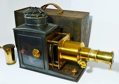 Victorian tinplate magic lantern, case and spare lens.  John Wrench,London