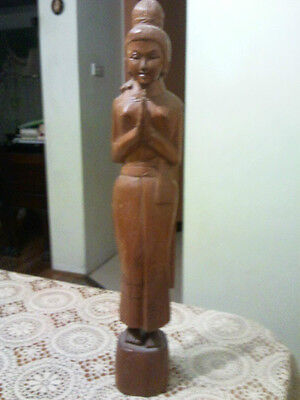 Solid wooden hand carved lady figurine.