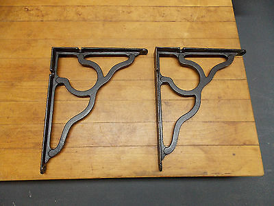 Pair of antique cast iron shelf brackets arts and crafts style