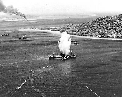 1944-Japanese freighter in Truk Atoll hit by torpedo dropped from TBF Avenger