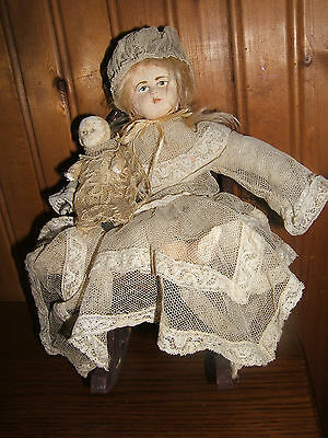 Antique Vintage Chalk Plaster Doll with Baby Doll In Rocking Chair
