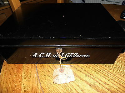 Antique Tala Metal safe box / cash box , with key , tag and painted names .