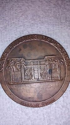 A Souvenir Medallion of the News Building Dedication from January * 1966