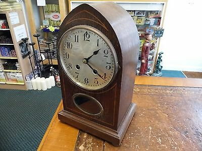 Antique mantle clock made by H.A.C ,  Lancet shape with inlay , chimes ,