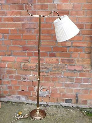 A Good Brass Floor Standing Reading Lamp In The Antique Manner