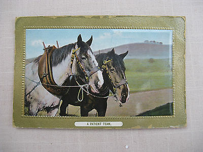 """Postcard. """"A Patient Team"""" 2 horses. Colour. Stamped and dated 1911"""