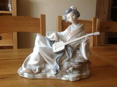Large Nao by Lladro. ( Geisha Woman playing a Quitar )