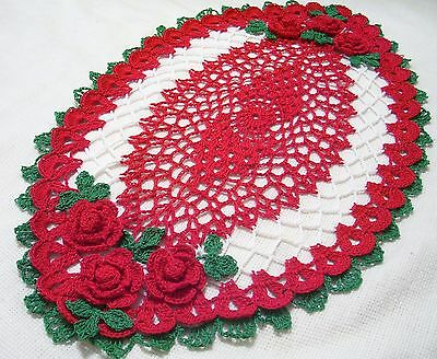 Holiday oval crocheted doily  by Aeshagirl