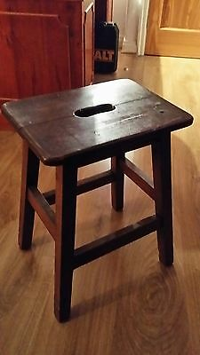 Vintage milking stool with carrying handle possibly antique but I don't know