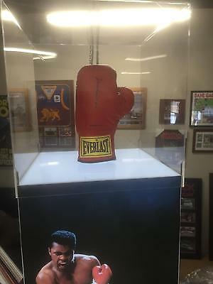 Muhammad Ali signed everlast boxing glove in a illuminated podium display