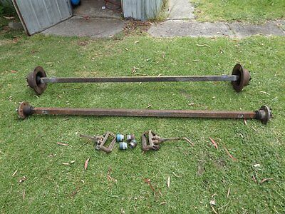 Trailer Axles x2 with hubs, disc calipers and bearing buddies