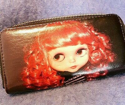 Wallet with image of a Blythe dolls head