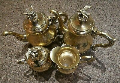 brass jugs and teapots