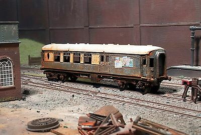 Abandoned accident damaged Pullman coach, heavily rusted & weathered