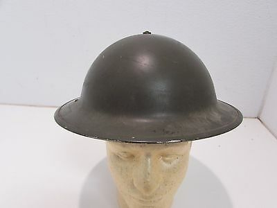 WWII British helmet 1942 dated with liner no chinstrap. Stamped C.L./C. 07 1942.