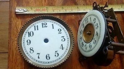 A SMALL CLOCK  FACE & small clock movement for spare &repair