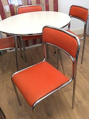 vintage retro Dinette in orange/chrome chairs and table